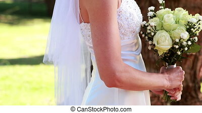 Bride holding a bouquet - Bride holding a bouquet on a sunny...