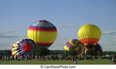 Hot Air Balloon Launch - Hot air balloons take to the sky...