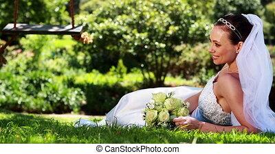 Pretty bride smiling at camera lyin - Pretty bride smiling...