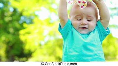 Cute baby boy playing with a pinwheel on a sunny day