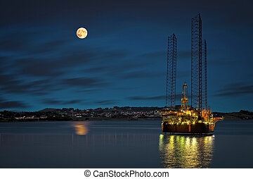 Offshore - Oil platform at night time and the moon.