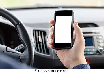man sitting in the car and holding a touch phone with...