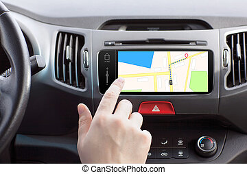 man sitting in a car and touch play finger in a navigation...