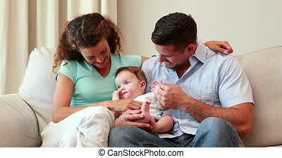 Young parents sitting on the couch