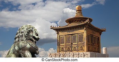 Bronze Guardian Lion Statue and bronze pagoda in the...
