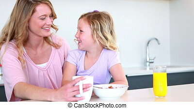 Pretty mother and daughter having b