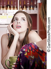 Woman in coffee house with female friend