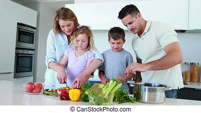 Smiling family preparing a healthy dinner together at home...