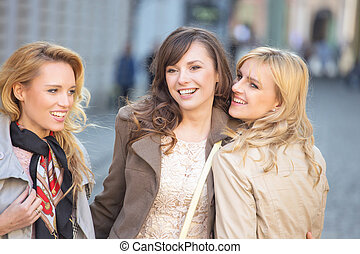 Three young beautiful ladies smiling