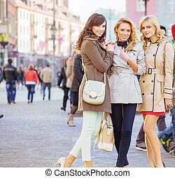 Three female friends in the old town