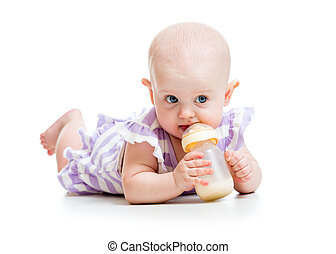 adorable child drinking from bottle. 7 months old girl. -...