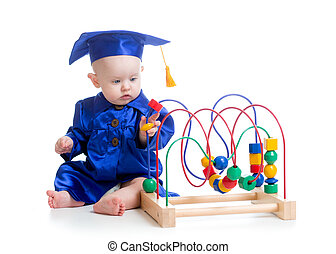 Baby in academician clothes with educational toy