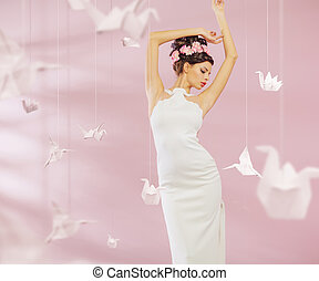 Attractive lady among the paper swans
