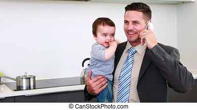 Father holding his baby son before