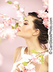 Relaxed girl smelling the spring flowers - Relaxed lady...