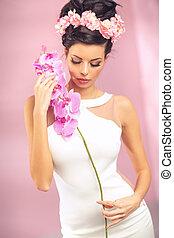 Sensual brunette girl with flower