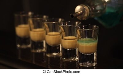 Shots in cocktail bar - Shots with whisky and liqquor in...