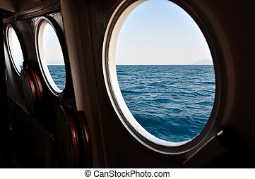 Open boat porthole with ocean view