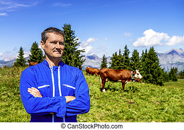Herdsman and cows - Herdsman standing in front of cows in...