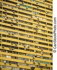 Yellow crowded residential building