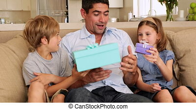 Cute children giving their father presents