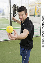 Paddle tennis player - Paddle tennis master ready for serve...