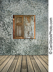 old wood window on concrete wall