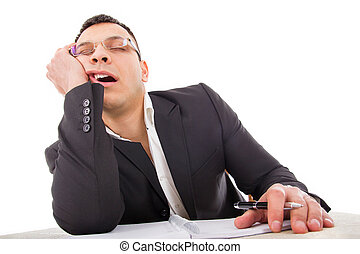exhausted businessman sleeping at his desk yawning with...