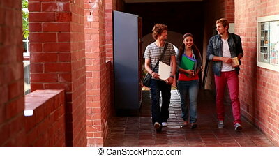 Students walking along the hallway