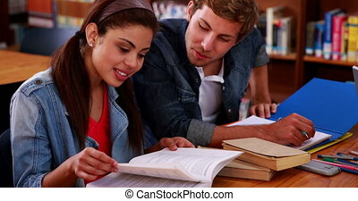 Students studying together in the l
