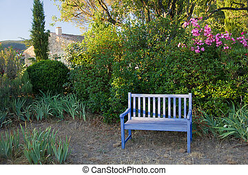 Blue painted wooden garden bench, Provence, France. - Blue...