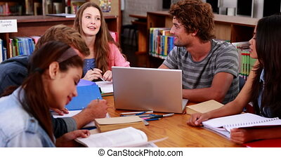 Students working together in the library at the university