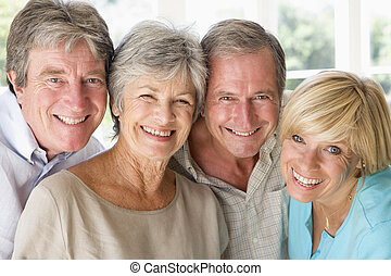 Two couples indoors smiling