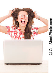 shocked casual woman with glasses looking at laptop and...