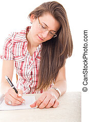 student girl wearing glasses with pen and notebook writing...