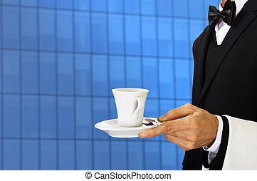 young waiter in uniform from work serves offices