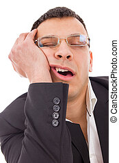 tired man with glasses yawning and sleeping at work
