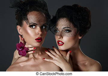 Fantasy. Pair of Desirable Gorgeous Women in Dark Veils. Togetherness