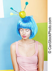 Joke. Eccentric Woman Oddball in Blue Wig with Darts and Green Apple