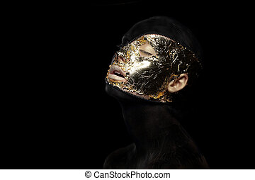 Fiction. Imagination. Futuristic Creature in Crazy Mystic Mask and Gilt