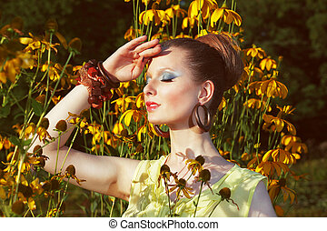 Relax. Daydreaming Woman over Floral Background with Flowers