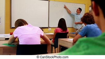 Lecturer talking to his class and answering a question at...
