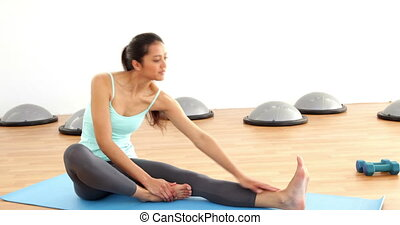 Fit brunette stretching exercise - Fit brunette stretching...