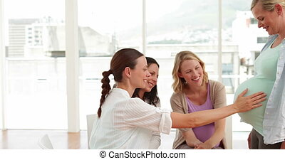 Pregnant women talking together