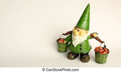 Gnome carrying coin buckets - Front view of a funny green...