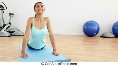 Fit brunette doing yoga exercise