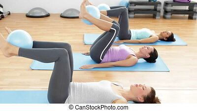 Fit women doing pilates together - Fit women doing pilates...