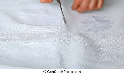 Cutting fabric with scissors - Close up of hands with...