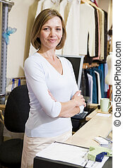 Woman at clothing store smiling