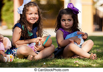 Little best friends and their dolls - Pretty little girls...